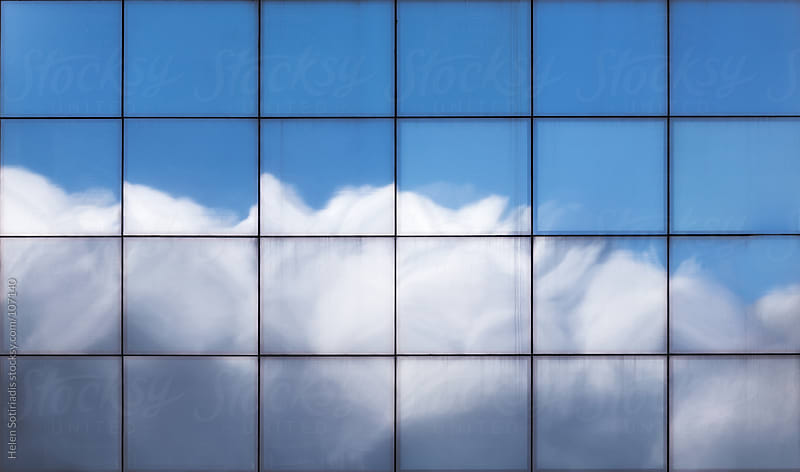 The Sky Reflected on an Office Building by Helen Sotiriadis for Stocksy United