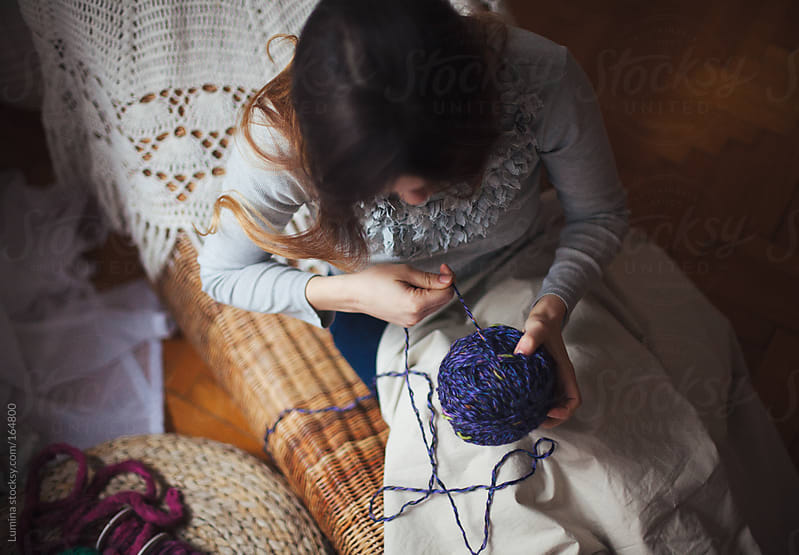 Woman Winding a Ball of Yarn by Lumina for Stocksy United