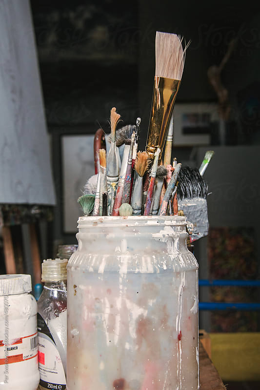 Jar of art brushes in artist's studio by Per Swantesson for Stocksy United