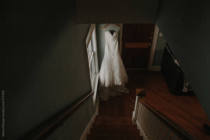 Wedding Dress Hanging Indoors by Sidney Morgan for Stocksy United