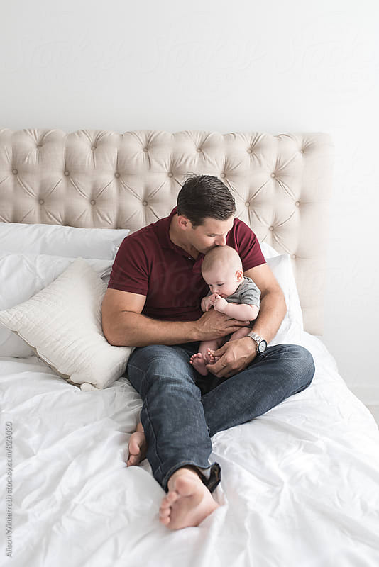 Father Kisses Son's Head by Alison Winterroth for Stocksy United
