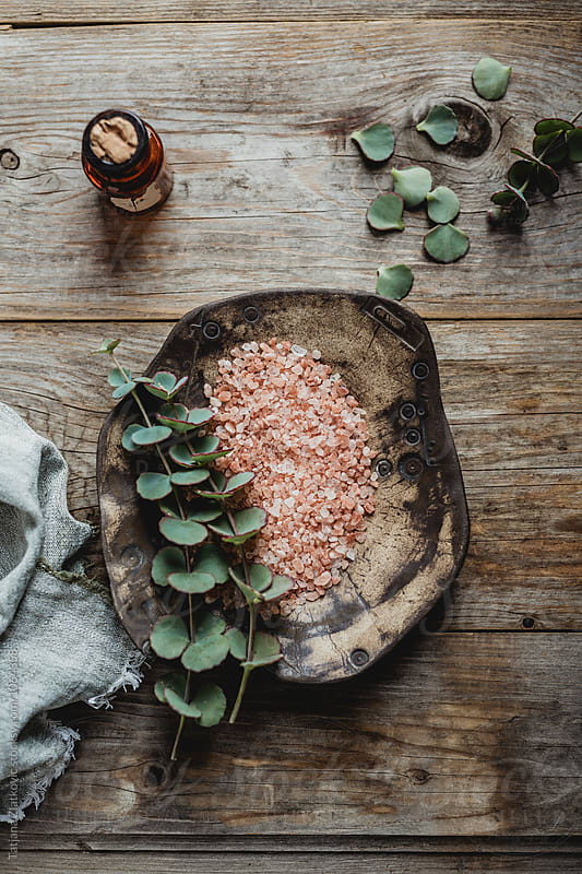 Himalayan pink salt on the table by Tatjana Ristanic for Stocksy United