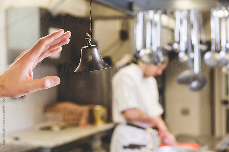Ringing the Bell in a Professional Kitchen by Giorgio Magini for Stocksy United