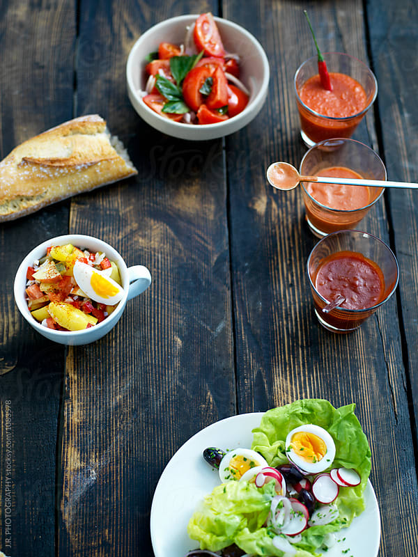 Salads and sauces at a picnic by J.R. PHOTOGRAPHY for Stocksy United