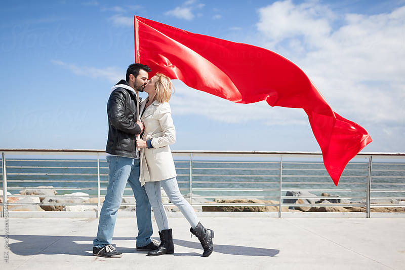 Lovers With Red Flag by HEX. for Stocksy United