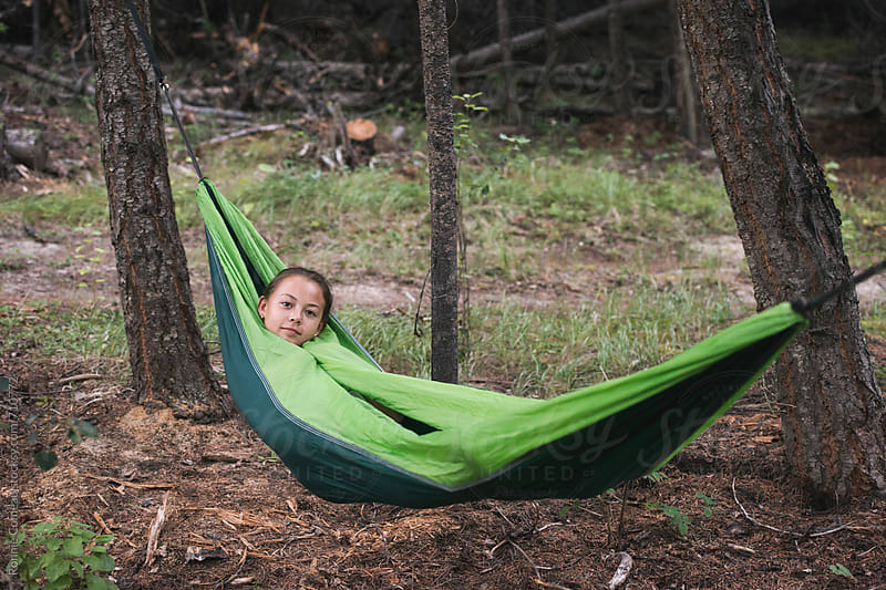 Preteen Girl Hammocking by Ronnie Comeau for Stocksy United