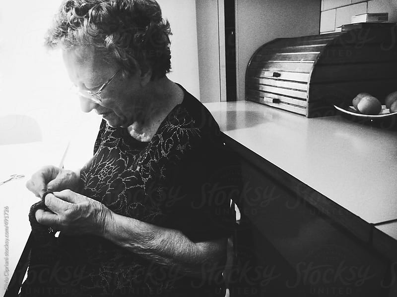 Grandma sewing by Silvia Cipriani for Stocksy United