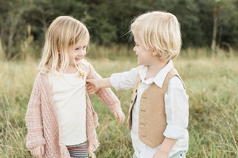 Brother and Sister Sharing A Silly Moment by Alison Winterroth for Stocksy United
