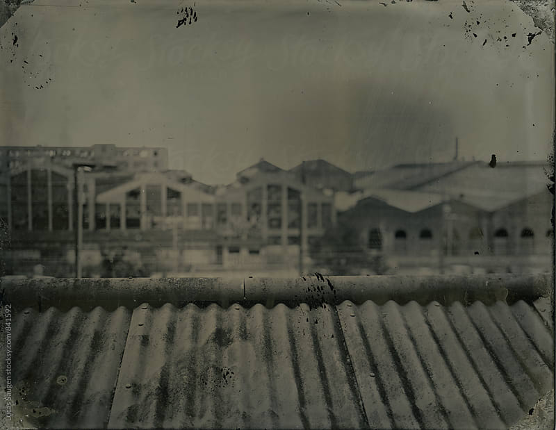 Wet plate tintype of old warehouses of San Francisco by Lucas Saugen for Stocksy United