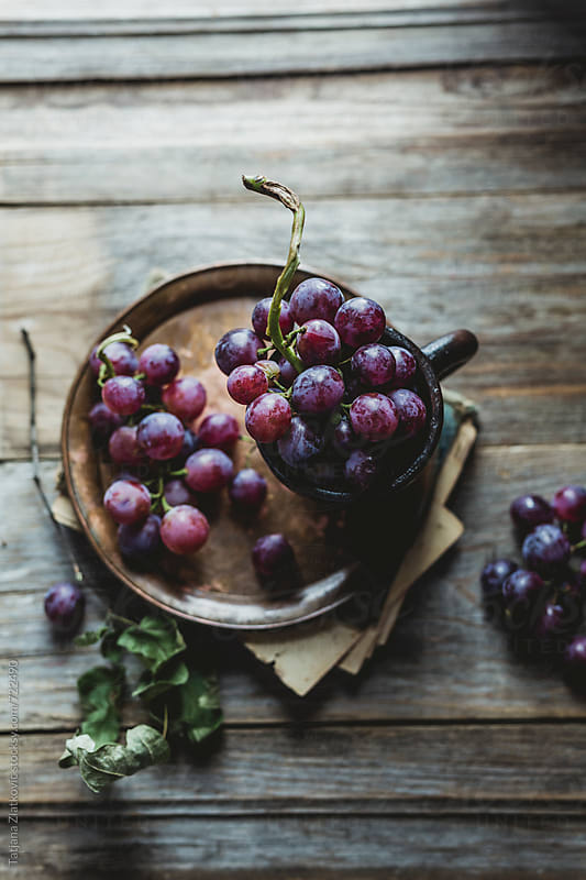 Grape on the table by Tatjana Ristanic for Stocksy United