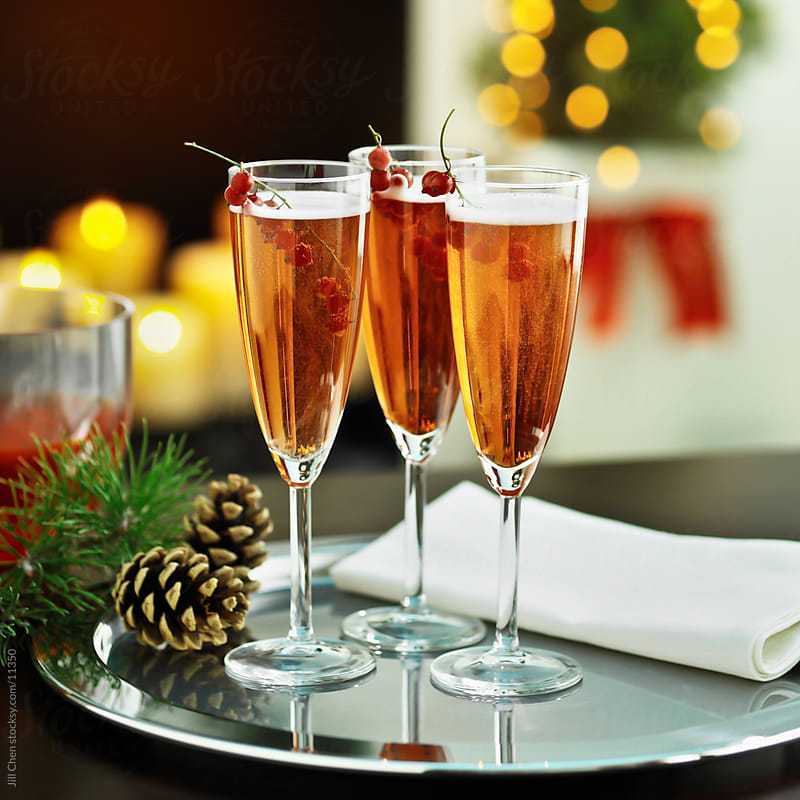 Festive Champagne Cocktails by Jill Chen for Stocksy United