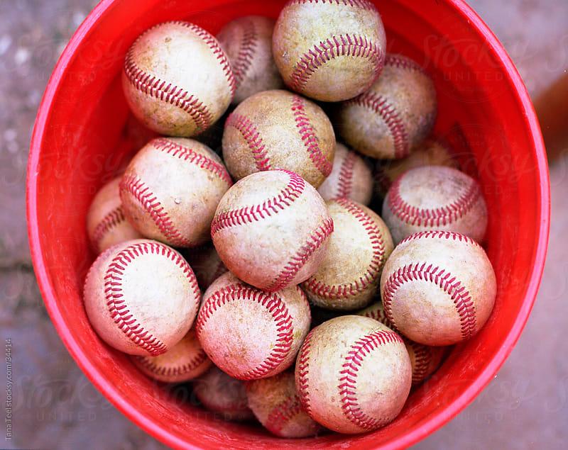 Bucket of baseballs shot on portra medium format film.  by Tana Teel for Stocksy United