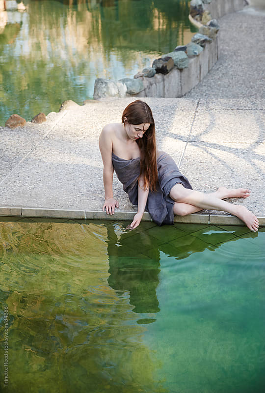 Woman relaxing at Japanese spa and hot springs by Trinette Reed for Stocksy United