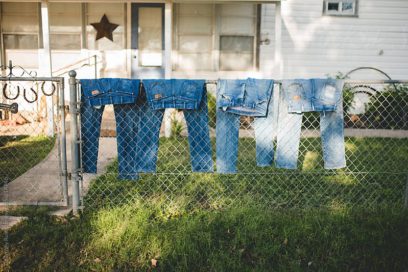 jeans in a row by Courtney Rust for Stocksy United