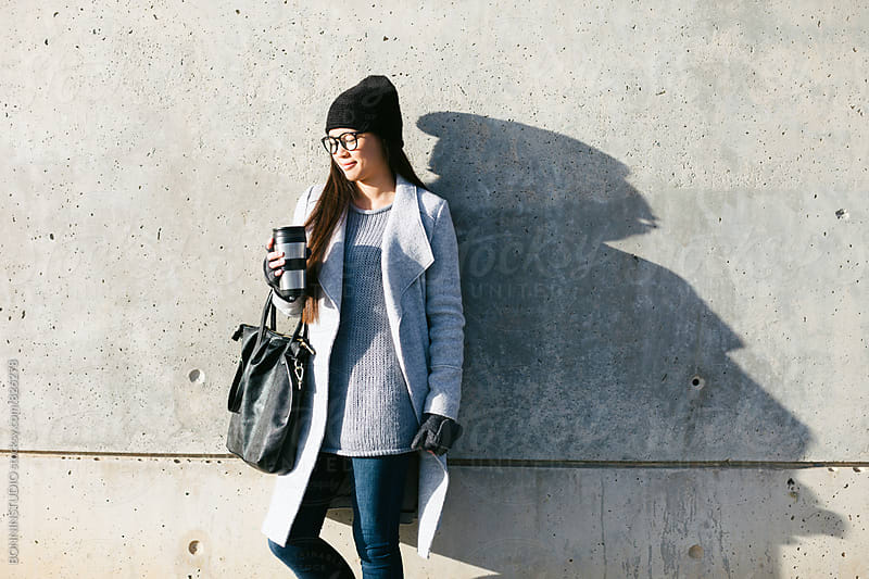 Woman wearing chic winter clothes in the city. by BONNINSTUDIO for Stocksy United
