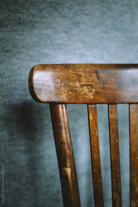 Wooden chair back in daylight by Vera Lair for Stocksy United