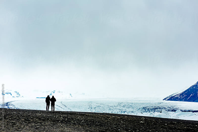Two hikers enjoying a glacier landscape in Iceland by Soren Egeberg for Stocksy United