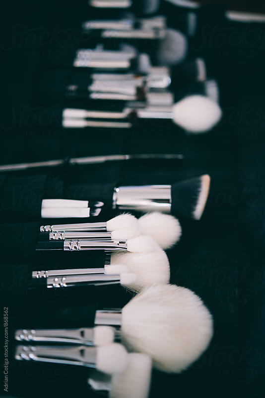 Close up of makeup  brushes. by Adrian Cotiga for Stocksy United