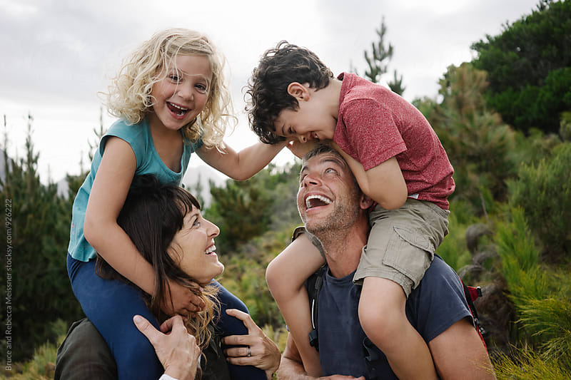 Family having fun by Bruce and Rebecca Meissner for Stocksy United