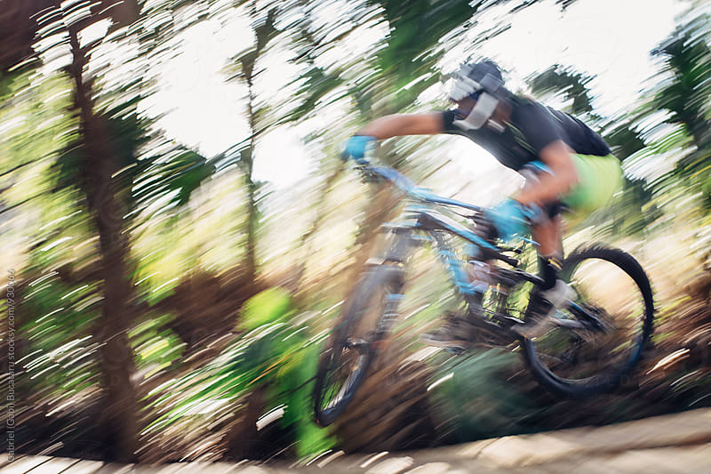 Motion blur of a mountain biker by Gabriel (Gabi) Bucataru for Stocksy United