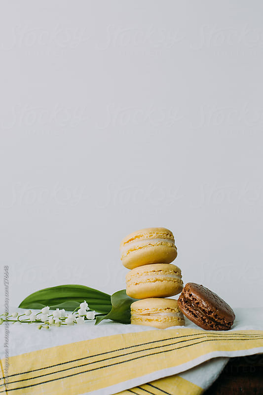 Stack of Macarons and Lily of the Valley Still Life by Alicia Magnuson Photography for Stocksy United