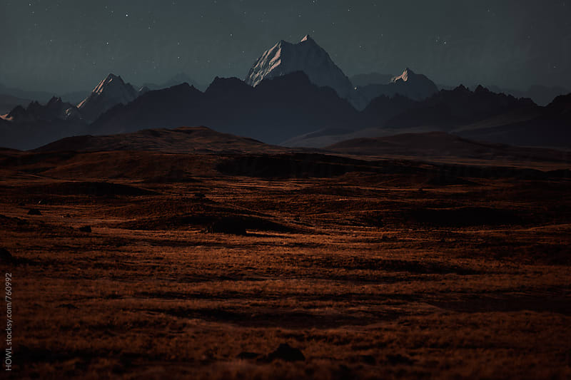 An interstellar landscape with a starry sky  by HOWL for Stocksy United