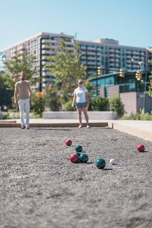 Friends Playing Bocce Ball by Cameron Whitman for Stocksy United