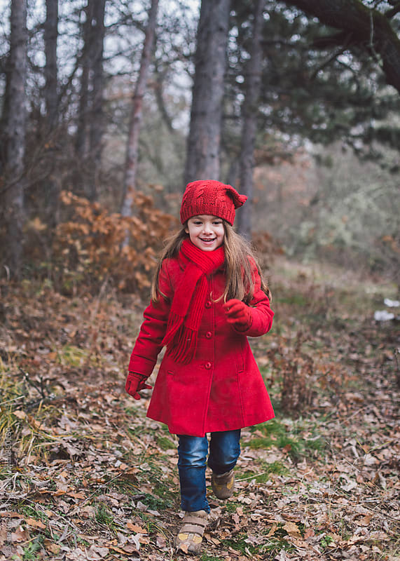 Sweet girl with red coat. by Dejan Ristovski for Stocksy United