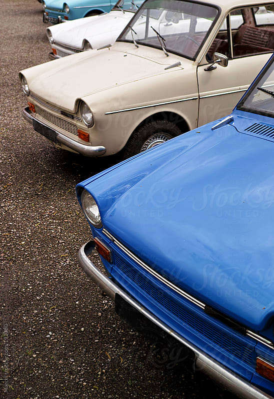 Row of classic little cars by Marcel for Stocksy United
