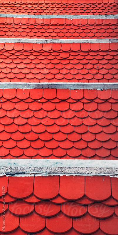 Bright red roof tiles pattern by Wizemark for Stocksy United