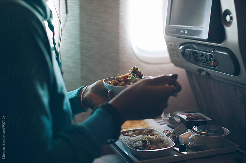 Anonymous Woman Eating On an Airplane by Mosuno for Stocksy United