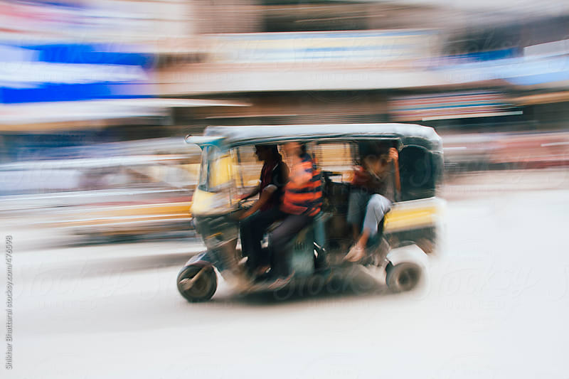 Abstract pan shot of a auto rickshaw in the Indian street. by Shikhar Bhattarai for Stocksy United