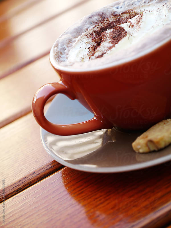 Hot Drink with whipped cream and biscuit by Jasmin Awad for Stocksy United