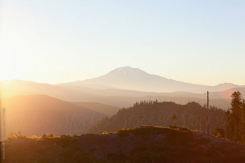 Mountains at sunrise by Linzy Slusher for Stocksy United