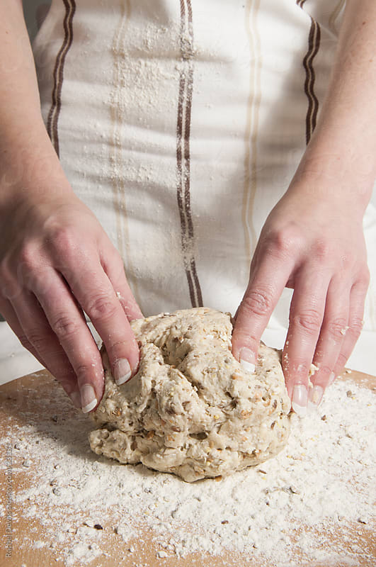 Making bread. by Rachel Dewis for Stocksy United