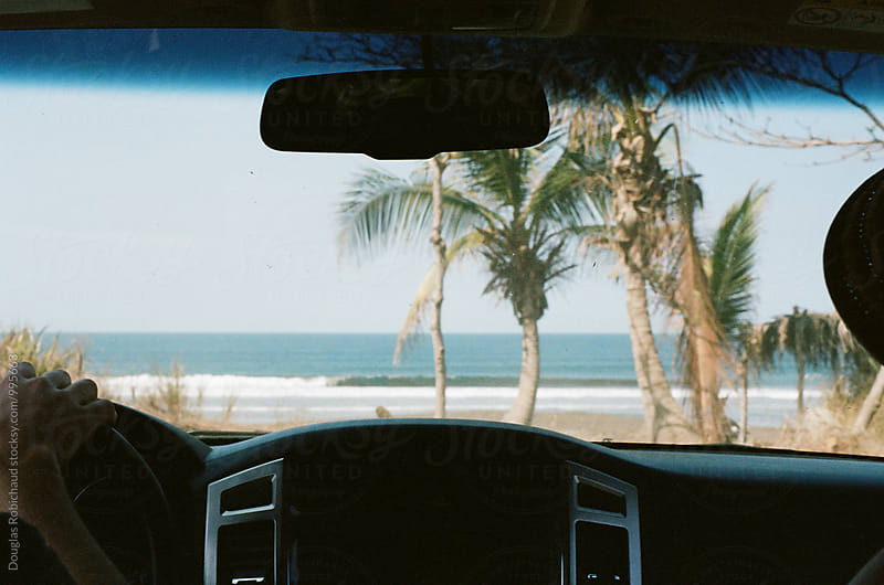 Car view of ocean by Douglas Robichaud for Stocksy United