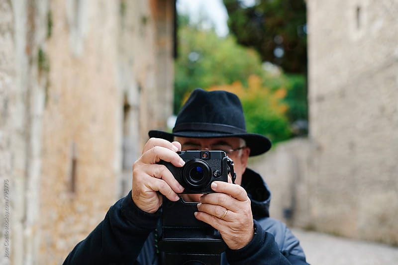 Man taking a photo by Jose Coello for Stocksy United