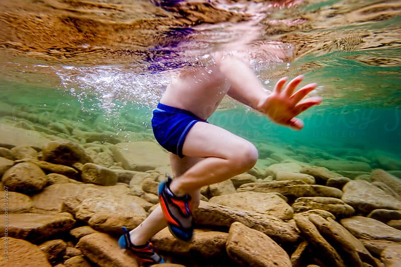 Little Boy Swimming Underwater in Cold Clear Lake in Summer by JP Danko for Stocksy United