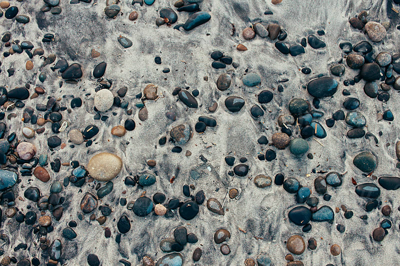 Beautiful stone pattern naturally  scattered on a sandy beach by paff for Stocksy United