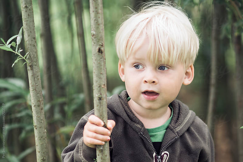3 year old boy outdoors exploring  by Per Swantesson for Stocksy United