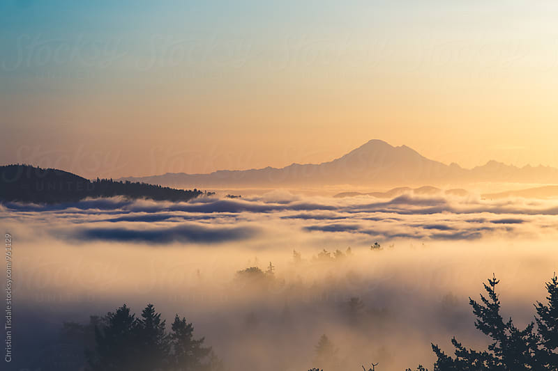 Mount Baker above a layer of fog by Christian Tisdale for Stocksy United