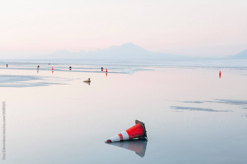 Traffic cones on flooded Bonneville Salt Flats at dawn, near Wendover, UT by Paul Edmondson for Stocksy United