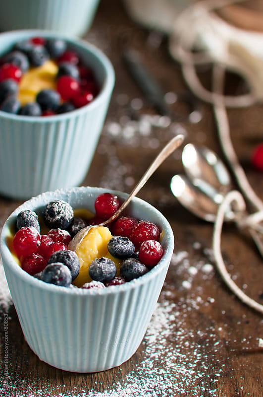custard with ribes and blueberries by Laura Adani for Stocksy United