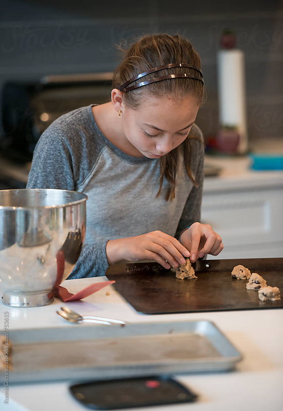 Preteen Girl Baking Chocolate Chip Cookies by Ronnie Comeau for Stocksy United