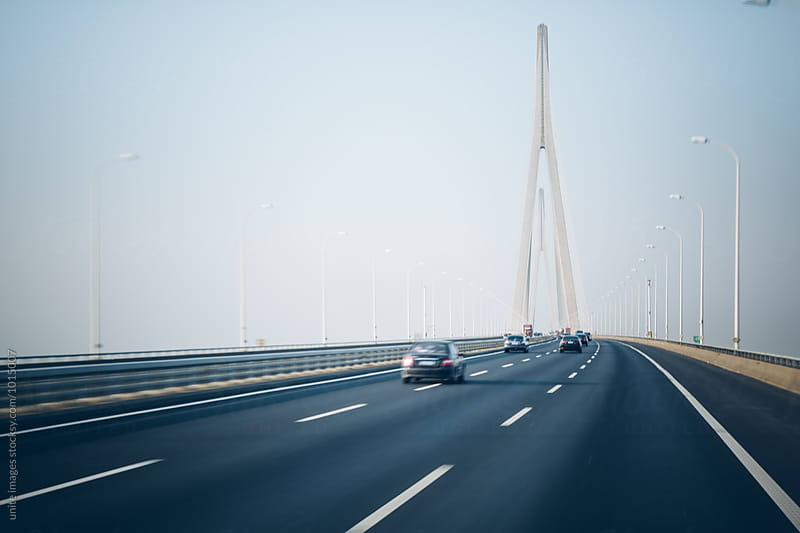 traffic at yangtze bridge,china by unite images for Stocksy United