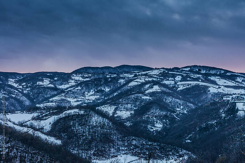 Winter afternoon in the mountains. Amazing view on the mountains in sunset. by Dimitrije Tanaskovic for Stocksy United