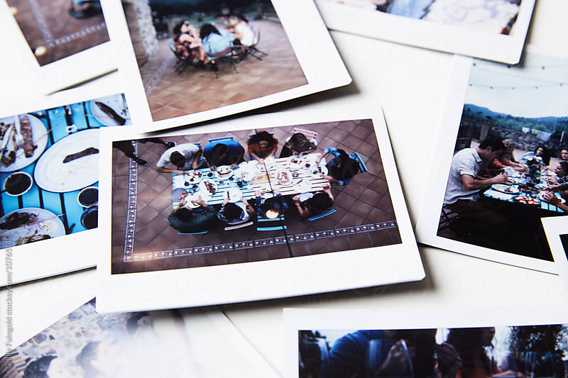 Still life of instant shots of  friends having dinner at terrace by Guille Faingold for Stocksy United