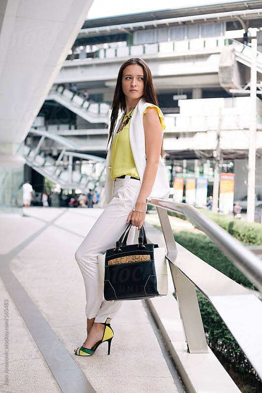 Business woman going to work by Jovo Jovanovic for Stocksy United
