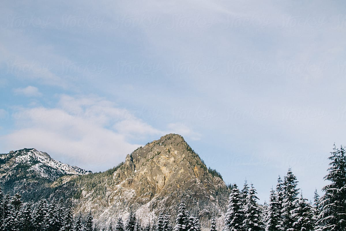 Snow covered mountain winter scenes by Jesse Morrow - Stocksy United