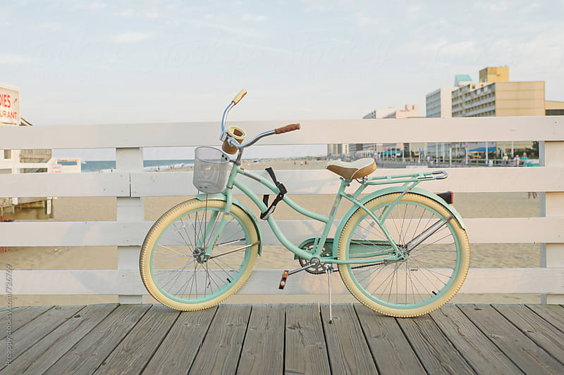 Bicycle leaning against boardwalk by Preappy for Stocksy United